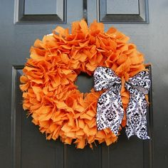 Orange burlap wreath. Cute, but I'd lose the bow.