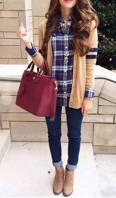 When you want to add a sophisticated spin to a plaid button-down, try covering it with a long cardigan and a sparkly statement necklace. Style tip: To pull off preppy the right way, go for matching elements as the key factor. This style blogger opted for neutral booties to match her sweater, and the color of her bag was pulled from the stripes in her shirt.