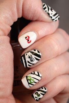 Rivka's Renditions: Halloween Nail Designs. Use vinyl to cut stencils for nail art!