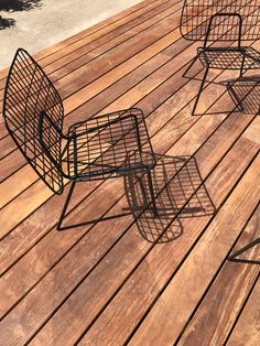 WM String Lounge Chairs designed by MENU throw striking shadows onto an outdoor deck at The Audo hotel in Copenhagen.