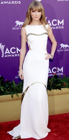 Look of the Day › April 2, 2012 WHAT SHE WORE Taylor Swift chose a cutout J. Mendel gown and pave bracelets for the ACM Awards. WHY WE LOVE IT The singer showed her more sophisticated side in a sleek white column glinting with her signature sparkle.