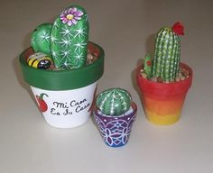Painted rock cacti by Rock Art USA