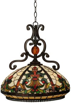 18 Inch W Baroque Pendant - 18 Inch W Baroque PendantIf your pendant isn't Baroque, you may want to replaceit with this intricately designed fixture. This Nouveaumasterpiece exudes a decidedly lifelike aura withcurved designs that grab your attention. This exquisitestained glass shade incorporates life affirming MotherEarth tones of Sandy Beige, Honey Gold and JungleGreen. The repeating design is bordered by Root Beercolored glass edges and the sturdy decorative hardwareis hand finished in a…