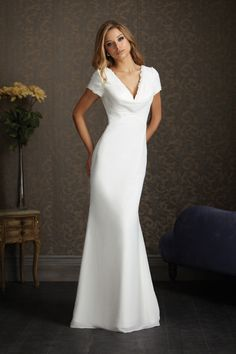 This is gorgeous and looks a little like Pippa Middleton's dress....If you want a wedding gown with sleeves with simple lines here's one