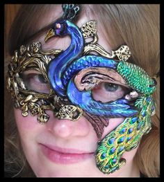 "So I normally ""hate"" to click onto for sale stuff, but I had to pin this as inspiration for a future craft weekend. :)  Peacock Mask by RobinRed on Etsy, $70.00"