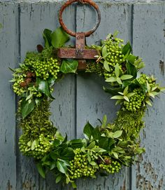 Welcome visitors with a handmade evergreen wreath on the front door. This one by blogger Minna Mercke Schmidt is constructed from moss, ivy, and eucalyptus wired into a frame. Plus: 9 festive DIY wreath ideas » - CountryLiving.com