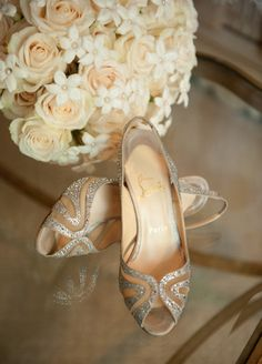 The bride accessorized herself with silver peep-toe pumps and a soft-hued wedding bouquet. #BridalShoes Photography: John Solano. Read More: https://www.insideweddings.com/news/fashion/real-brides-share-their-loveliest-louboutins/1240/