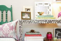 'podge an inexpensive shelving unit with snakeskin fabric to raise its glam factor