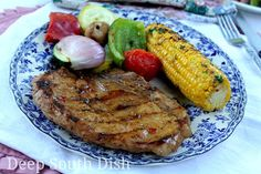 Bone-in pork loin chops, first marinated in a brown sugar, vinegar and soy marinade, then grilled and brushed with a pepper jelly glaze to finish. Shown here with  my chargrilled corn and grilled veggies.