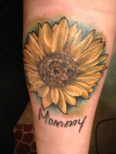"""My tattoo  A sunflower with """"Mommy"""" written in my mothers handwriting. The handwriting I pulled off of one of the letters she sent me while I was in US Naval boot camp. This woman means more to me than shell ever possibly know. I love you so much mommy!(@Amy Lyons Stenberg) this is by far my favorite piece! Thank you for always giving me the most wonderful life. Even when you didn't agree with me you were still there. You mean the world to me. ❤ This ones for you."""