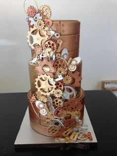 "Our ""Steam Punk"" themed wedding cake with cascade of hand crafted fondant gears, locks, keys, and clocks! We're only a little obsessed! www.gimmesomesugarLV.com"