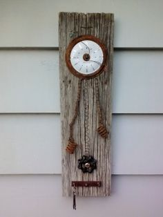 Non-working clock - salvaged fence board, springs, bike chain, clock face, rusty metal, valve....