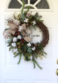 Christmas Wreath for Front Door-Cotton Boll Wreath-Holiday Wreath-Christmas Wreaths on Etsy-Rusted Sleigh Bells-Cotton Boll Decor-Farmhouse Wreath-Winter Wreath Celebrate your holidays with this wintery farmhouse wreath. A beautiful collection of realistic evergreens, including scotch pine, Frasier fir, long-needled white pine and frosty cedar is mixed with seeded eucalyptus, pine cones, red pip berries and fluffy white cotton bolls. A trio of rusted sleigh bells is featured as the center…
