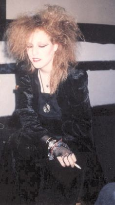 I looked like this in 1987. Hung out in graveyards, only drank black drinks, smelled of patchouli. Lol