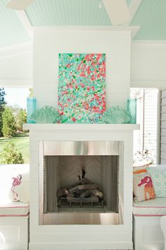 Mint & Coral back porch with a fireplace
