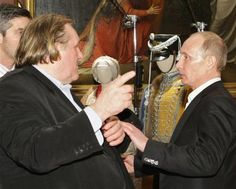 Et toi Gerard? French actor Gerard Depardieu (L) speaks with Vladimir Putin (R), then Russian Prime Minister, during a meeting in St.Petersburg in this December 11, 2010 file photo. REUTERS/Alexei Nikolsky/RIA Novosti/Pool/Files