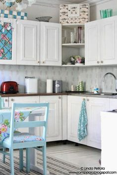 White country kitchen, old vintage wallpaper as a backsplash, plexiglas on top.  http://romppala.blogspot.com