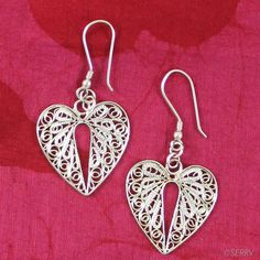 Filigree Heart Earrings  Intricate swirling filigree detailing draws the eye to these silver-plated copper earrings. Sterling silver hooks. 2in. l #FairTrade #Valentine #Fashion www.serrv.org