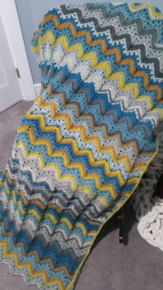 6 day kid blanket. Caron Big Cakes -3 blue macaron and 2 honey glazed (rows 5 and 6). 12 peaks, 220 sts
