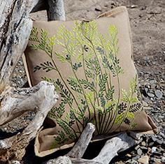 Embroidered with fern fronds, this pillow brings natural beauty to indoor and outdoor settings.