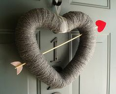 valentines day decor...needs to be a different color  I can  use a foam wreath heart, a wooden skewer and a heart sticker
