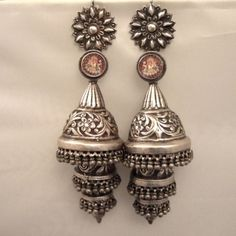 """Silver, India   Description  A pair of earrings (unique antique) from Rajasthan called """"phuljhumka"""" and worn by Gypsy Lambadi or benjara nomads: in this case,  the three levels, the  floral designs are truly amazing ... these earrings are dedicated to Ganesh as shown in the small thumbnails under glass in the upper part of the earrings ...  these earrings are pieces for discerning collectors ...  Weight:99,85gr et102,70 gr    Height:6,49 inch    www.halter-ethnic.com...see """"My Lucky Finds"""""""