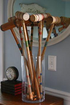 Croquet mallets in vase