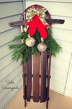 christmas antique sled and sweater mittens winter porch decor, christmas decorations, porches, repurposing upcycling, seasonal holiday decor Christmas Sled, Rustic Christmas, Simple Christmas, Christmas Wreaths, Christmas Crafts, Christmas Ideas, Outdoor Christmas, Vintage Christmas, Holiday Ideas