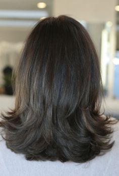 natural brunette hair color. I like how the hair falls on her shoulders.