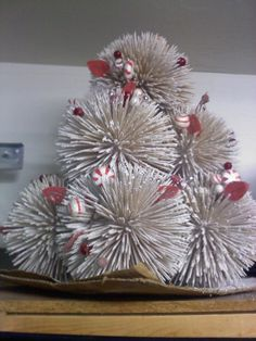 I made this cute little Christmas Tree out of styrofoam balls, toothpicks and spray snow. Add in any small ornaments you like :o)What a cleaver idea I learned from Blake's mom.