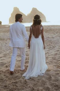 Bohemian beach / destination wedding love. White groom tux. @Megan Hudson