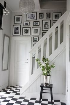 Another simple display using the same type of black frames but different image sizes along hallway