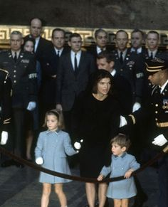 John F. Kennedy's family standing at his funeral.
