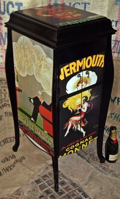 Decoupaged old grammaphone unit revamped into a drinks cabinet!