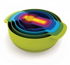 Nesting bowls, measuring cups, strainer, all fitting together in a beautiful range of colors