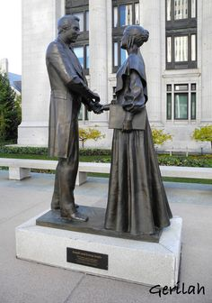 Statue of Joseph and Emma Smith, founders of the Mormon Church, in front of the Church Office Building, headquarters of The Church of Jesus Christ of Latter-day Saints. Located in: Salt Lake City, Utah - sculpture by F P Hansen. October 2013