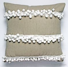 I love perusing pricy websites to see what I can replicate. When I came across the Tassel Trace Pillow on the Anthropologie website I knew I had to make it