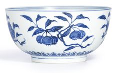 EXTREMELY RARE BLUE AND WHITE 'FRUIT' BOWL, MING DYNASTY, YONGLE PERIOD the deep rounded sides rising from a short foot, vividly painted on the exterior with detached fruiting branches of peach, crabapple, pomegranate and longan, above a band of overlapping petals encircling the foot, the cobalt of an attractive blue tone with pronounced characteristic 'heaping and piling' effect 19.7 cm.