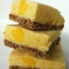 skinny mango cheesecake bars - I might change up the crust, but the rest sounds delicious! Vegan Treats, Yummy Treats, Sweet Treats, Yummy Food, Raw Desserts, Holiday Desserts, Dessert Recipes, Mango Desserts, Mango Cheesecake