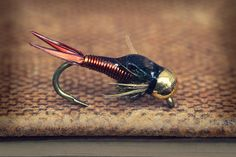 My all-time favorite nymph pattern - the Copper John. Tye them up using other wire colors as well. The addition of a bit of glossy epoxy over the back adds a nice look and some durability.