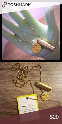 "Fighting Hunger Bullet Necklace The ""Fighting Hunger"" bullet necklace represents your fight against global hunger using ethical fashion. We've taken something that is usually seen as a symbol of harm, and turned it into a positive symbol of hope.  Every HALF UNITED product sold provides 7 meals for a child in need!  Gold plated 30"" gold ball chain.  Gold plated charm that reads ""HALF UNITED FIGHTING HUNGER.""  Handmade in the USA. Half United Jewelry Necklaces"