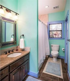 Fun, colorful bathroom with tile floor and granite coutnertops