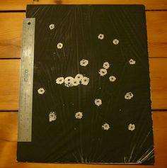"""DIY """"Shoot n see"""" Targets - white garbage bag over cardboard, spray paint black over top"""