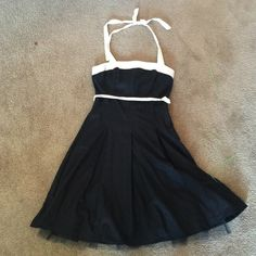 Beautiful eyelet dress with sash and halter tie Black & white eyelet dress with white sash tie, halter tie and tulle around bottom of skirt. In perfect condition! Hits below knees. B.Darlin Dresses