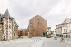 Gallery of Village Center of Ecouflant / Studio d'Architecture Bruno Huet - 14
