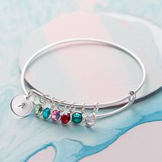 Family Birthstone Bangle. A silver plated adjustable bangle adorned with swarovski crystal birthstones in the shade of your choice, customised to represent your own unique family.