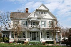 Victorian house with spring landscape