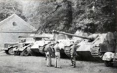 The spoils of war. Allies guard a seized German Zugkraftwagen and two Panther tanks.