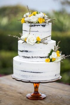 Semi naked wedding cake with floral decorations