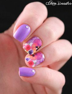 Purple with floral pansy nail art